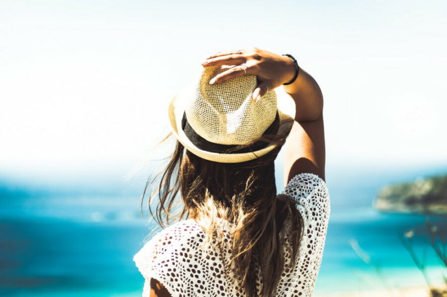 Summer and Hair Loss - Girl Holding Hat Outdoors